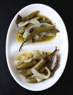 Pickled Serrano Chiles by Saveur. These chiles add tartness and heat to everything from tacos to scrambled eggs. Canning Pickles, Burger Toppings, Portuguese Recipes, Canning Recipes, Stuffed Hot Peppers, Mexican Food Recipes, Mexican Cooking, Scrambled Eggs, Gourmet