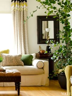 Love everything in this pic, esp the plants and the green piping on the sofa!