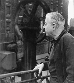 Robert Doisneau  //   Jacques Prevert sur le pont de l'Hôtel du Nord ,ca. 1960