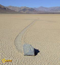 "The ""sliding stones"" is a geographical phenomenon that takes place around Racetrack Playa in Death Valley, USA. Every two or three years, large rocks gradually move along a smooth valley floor without human or animal intervention. The force behind their movement remains a mystery to this day! Photo: Lgcharlot"