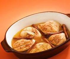 Baked Pears with Cranberry–Apple Reduction | A recipe by Top Chef contestant Andrea Beaman, pears are simmered in a bath of apple and cranberry juices along with cinnamon sticks and cloves. This aromatic dessert is a great use for bountiful winter pears.