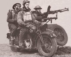 Canadian troops with a Bren gun mounted on a sidecar-wheel-drive circa 1940.