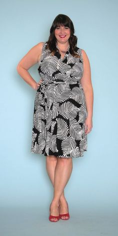 This black and white wrap dress is actually a faux wrap dress - meaning you get the look of a classic wrap dress but with more coverage! This sleeveless dress with a tie for the waist also features a
