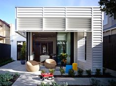 Sandringham Residence is a family cottage addition by Techne Architecture alongside Doherty Design Studio, sited in Sandringham, Auckland City, New Zealand. Auckland, Lofts, Design Studio, House Design, Modern Outdoor Living, Modern Patio, Weatherboard House, Queenslander, Melbourne House