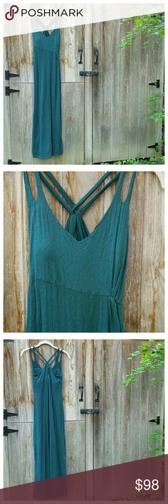 """Athleta Knotted Nanda Maxi Dress Gorgeous deep green maxi sundress with asymmetrical empire waist, removable molded bra cups and double crossed shoulder straps with keyhole back. Semi-sheer burnout fabric with full solid lining. Length approx 53"""" from shoulder, 44"""" from center front. Width at bust 14"""", width at empire waist 11.5"""", side slit 22"""".  Has stretch. Cotton/poly,, machine wash/dry.  EUC. Athleta Dresses Maxi"""