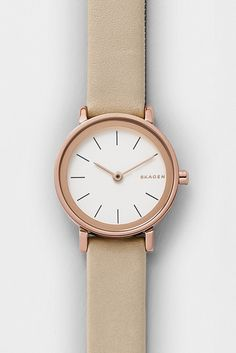 The classic sandblast dial of the 34mm Hald watch gets subtle shine from crystals punctuating each linear index. The watch is finished with a simple leather band.