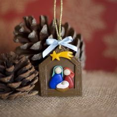 Cute little manger made of polymer clay <3 Tree xmas ornament.