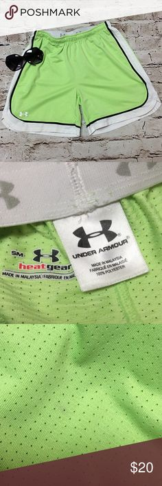 INDER ARMOUR BRIGHT GREEN HEAT GEAR SHORTS These shorts are gently used with the Under Armour logo Waistband. One tiny spot that's  not noticeable Under Armour Shorts