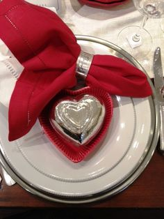 I love the look of adding a heart on your place setting to dress up your Valentine dinner setting. Place setting from Pottery Barn