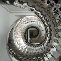 Tentacle-Like Tubular Slide Swirls Through NYC Penthouse