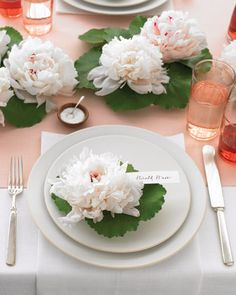 Good Things for Fall Weddings  Floating Flower Table Decor    Keep the cross-table conversation flowing with elegant, low floral runners and place card holders. They're easy on the eye and easy to re-create. Enlist lush peonies and gaylax leaves to compose your arrangements, then scatter artfully down the center of your reception tables.