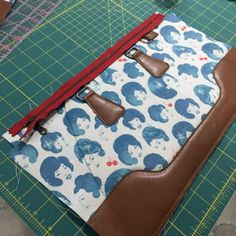 Apply fabric glue or DST to the backside of a Leather Bags Handmade, Handmade Bags, Bag Patterns To Sew, Sewing Patterns, Leather Bag Pattern, Diy Bags Purses, Quilted Bag, Sewing Basics, Knitted Bags