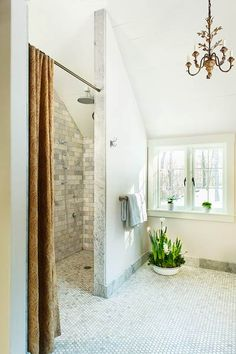 The centerpiece of this master bath is a curbless shower. Measuring 4 by 8 feet, the fixtures are placed so that you can fine-tune the water temperature before stepping into the spray. | Photo: Anthony Tieuli | thisoldhouse.com
