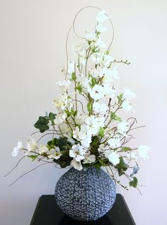 Tall Floral Arrangement, Silk Flower Arrangement - This tall arrangement uses top quality artificial white dogwood stems arranged as if they were just picked with ivy, natural ting ting, and vines placed in a unique gray polyresin container.
