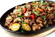 """FILIPINO Sisig was recently named as the """"greatest pork dish"""" in the world. Learn how to cook this delicious and easy to prepare Filipino recipe. Filipino Dishes, Filipino Recipes, Asian Recipes, Ethnic Recipes, Filipino Food, Chicken Sisig, Pork Sisig, Comida Filipina, Gourmet"""
