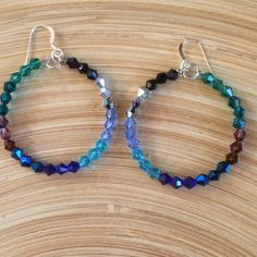 Crystal hoops These are 1 1/2 hoops that are a beautiful color wheel   They are made from 9 colors of glass crystals. They have 925 Sterling silver ear wires. Handmade by me NWOT Jewelry Earrings