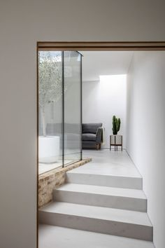A glazed courtyard and roof lights draw daylight into this small house in south London, which was designed by local studio Hayhurst and Co.