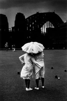 Trent Parke. Sydney. Two women bowlers huddle in the rain at North Sydney bowling club on a cold winters day