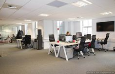 Contemporary open plan office with glazed office partitioned walls www.jbhrefurbishments.co.uk