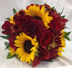 Beautiful fall colored weddings. Deep reds and sunflower. Bridal bouquet Made by countryside florist.