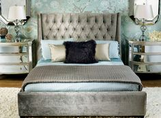 Traditional glam! Love the upholstered bed and mirrored night tables.