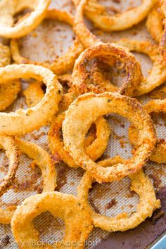 How to Make Crispy Baked Onion Rings. Made in the oven, not the frier. Much healthier! Recipe at sallysbakingaddiction.com