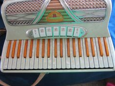 Vintage Italian Accordian   My first accordian had these same orange sparkley keys.. I picked it out myself!
