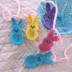 "Crochet bunny ""peeps"" For sale on this page, but I think they would be easy to figure out....  Crochet Bunny Garland - Easter Bunny Marshmallow Peeps Garland Banner in Bright Yellow, Pink, Purple Turquoise Crochet Easter Bunny Garland. $20.00, via Etsy."