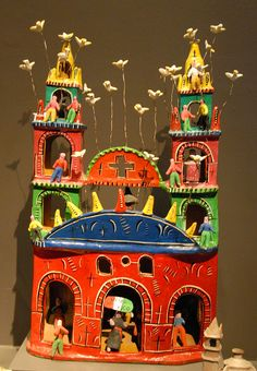 This colorful miniature Mexican church was made by Eva Flores Rodriguez from Jalisco, Mexico. Museo de Arte Popular. Mexico City