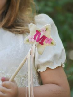 Personalized felt wand on Etsy. Lovely little holiday gift for kids, under $15.