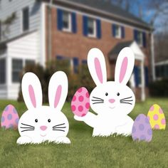 Cute bunnies and colorful Easter eggs for the garden