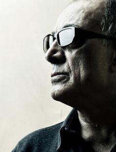 Abbas Kiarostami (Iranian drama director: خانه دوست کجاست؟ [Where Is The Friend's Home, 1987],زندگی و دیگر هیچ [Life, and Nothing More.../ And Life Goes On, 1992],نمای نزدیک [Close-Up, 1990],طعم گيلاس [Taste of Cherry, 1997],باد ما را خواهد برد [The Wind Will Carry Us, 1999]).