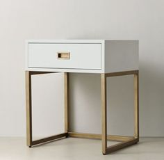 RH TEEN's Avalon Open Nightstand:The sleek lines of our collection exemplify the sophisticated restraint of modernism, while its polished cast-brass fittings – including recessed pulls and a metal base – take the composition in a stunning new direction.