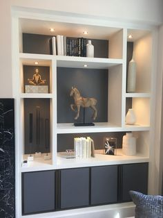 Beautiful Living Rooms With Built In Shelving The Spruce - Traditional White Built Ins With Closed Storage On The Bottom And Open On The Top Are So Versatile That They Can Fit Into Just About Any Style Of Living Room Choosing A Simple Cabinet Style Will E Built In Shelves Living Room, Living Room Partition, Room Partition Designs, Living Room Tv, Living Room Divider, Living Room Storage Units, Built In Cupboards Living Room, Wall Cabinets Living Room, Built In Tv Wall Unit