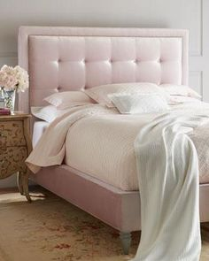 Beds/headboards - Pale pink velvet wraps around the tufted back of this luxurious bed.
