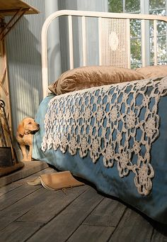 Crochet coverlet by Blue Sky Alpacas.  Loving the casual nature of this room and the puppy is so cute!!