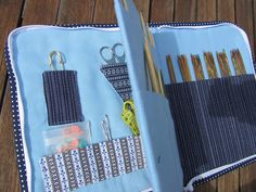 Zippered knitting needle organizer by Just-Do.  She also has an Etsy shop (JustDo).