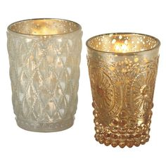 Cast a flickering glow on the kitchen table or foyer console with this glass candleholder, featuring hobnail details. Product: