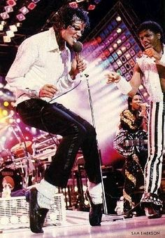 Michael Jackson, Randy Jackson, and Jermaine Jackson live during the Victory Tour.