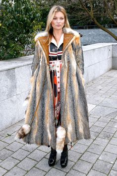 """Who: Kate Moss What: A Boho Dress Why: The always-in-style super paired a patchwork bohemian maxi dress with a long fur for a look that says """"I'm luxe and with the band."""" Get the look now: Needle and Thread dress, $630, net-a-porter.com."""