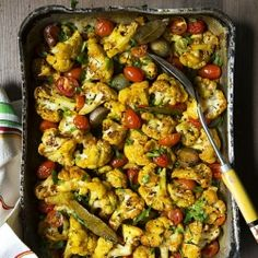 Turmeric Slow-Roasted Cauliflower with Cherry Tomatoes & Cannellini Beans, a delicious & aromatic way to cook cauliflower.