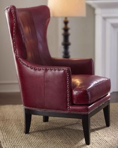 """Reba"" Leather Wing Chair at Horchow. Top grain leather with down blend seat cushion and nailhead trim."
