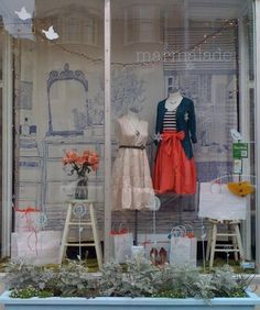We love the back wall and the planter outside this beautiful boutique window.
