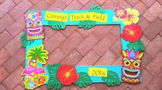 Luau photo op frame.  Used the middle section of an old science fair board. Decs…