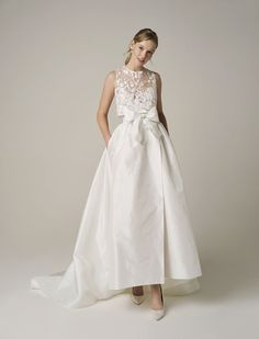 If you love Princess Diana's wedding dress or you're a bridal trendsetter, you'll want to hear the news: taffeta wedding dresses are back! Style 251 by Jesus Peiro