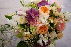 Lily of the valley, sweet peas, peonies, jasmine, English garden roses, and hydrangeas compose this lush bouquet.