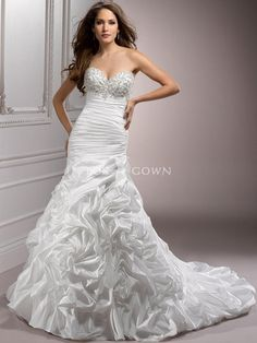 taffeta fit and flare wedding gown with ruched bodice and richly embellished bust cap-sleeves