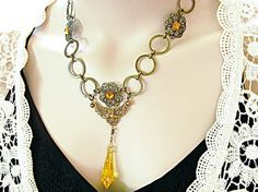 $55  Romantic necklace with Swarovski yellow prism crystal. Amazing colors and unique filigree components and round circle chain. Unique and funky necklace!