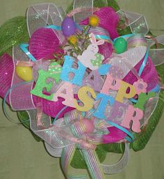 Easter Wreath pink green deco mesh wreath wooden sign Happy Easter with Easter eggs.
