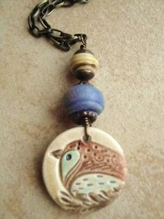 Ceramic Pottery Bird Denim Artisian Glass bronze long necklace. $34.00, via Etsy.